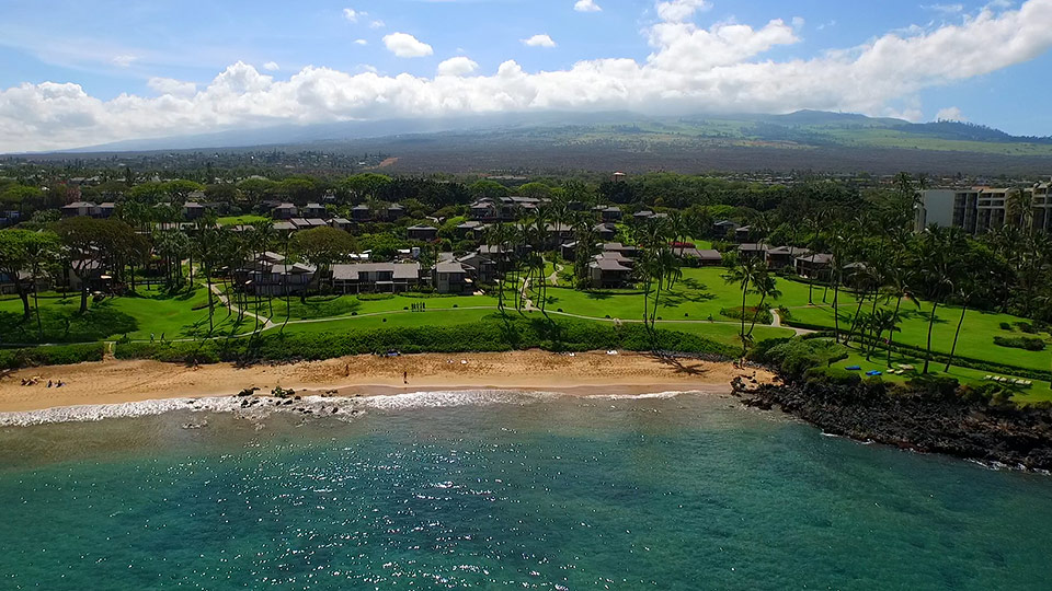 Aerial view of West Maui resort beach.