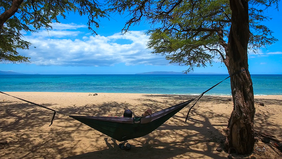 Relaxing in a hammock on the beach.