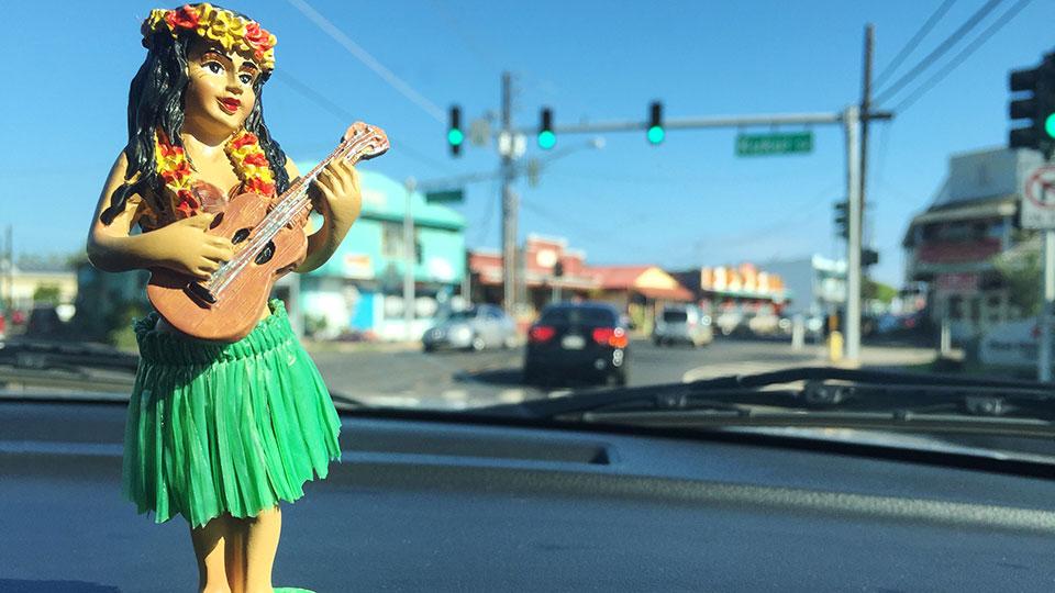 Dashboard Hula Girl driving through Kapa'a Town.