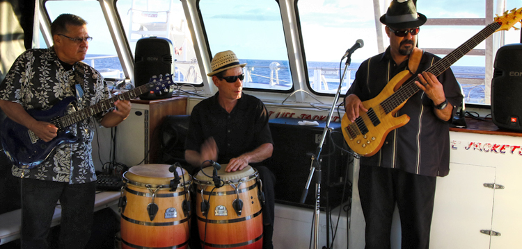 Joe Cano and band players performing on board the Pride of Maui sunset dinner tour.