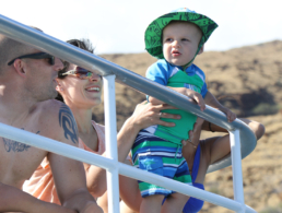 Young baby with looking at the ocean in amazement.