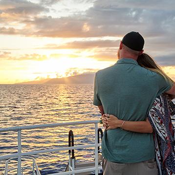 couple enjoying maui sunset amenities